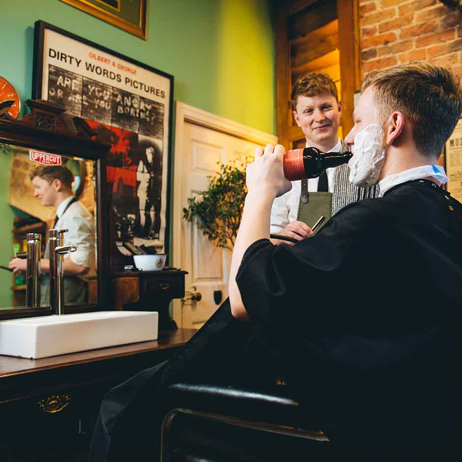 brass castle having a beer at the barbers