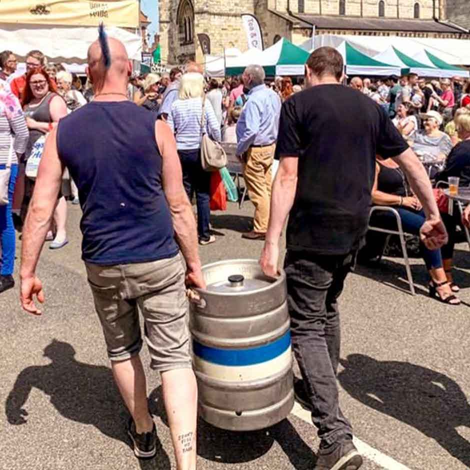 two guys carrying keg